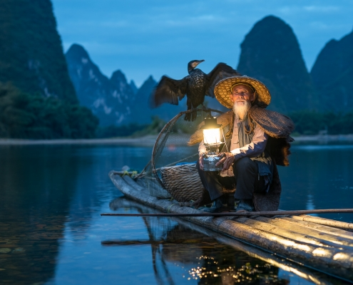 Old Chinese kormoran fisherman near Guilin, Yangshuo, China