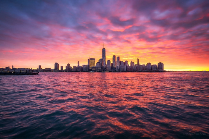 Manhattan skyline with One World Trade Center at sunrise seen from New Jersey, New York City, USA
