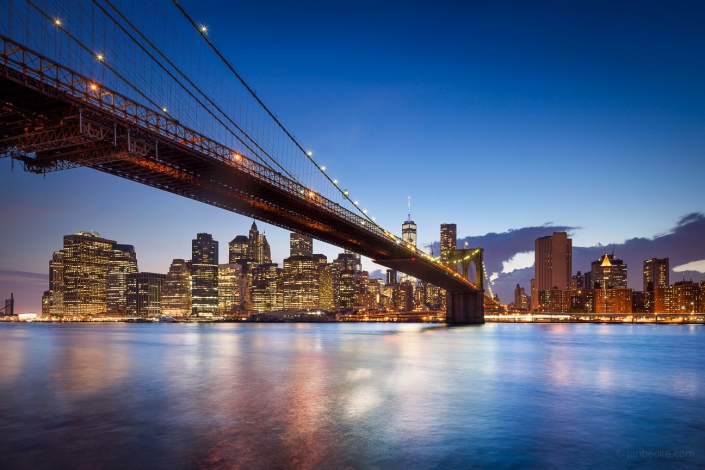 Brooklyn Bridge and Manhattan skyline at dusk, New York City, USA