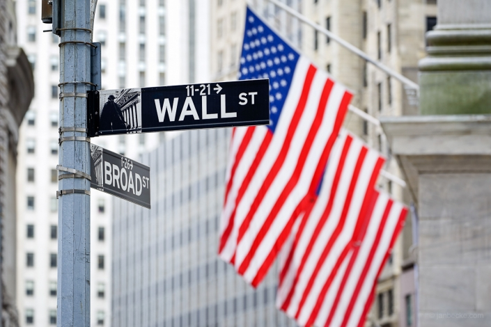 Wall Street street sign and Flag of the United States of America, New York, USA