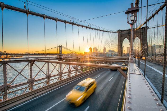 Yellow New York City Taxi Cab crossing the Brooklyn Bridge