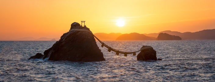 Meoto Iwa also known as the Wedded Rocks during sunrise, are two sacred rocks in the ocean near Futami, a small town in Ise City, Japan