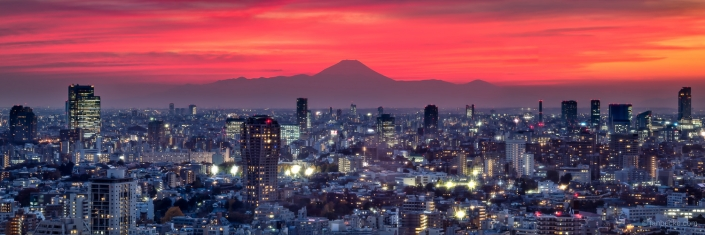 Tokyo skyline at sunset with Mount Fuji in a distance