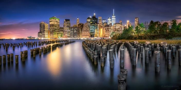 Downtown Manhattan skyline at night seen from Pier 1, Brooklyn Bridge Park, New York City, USA
