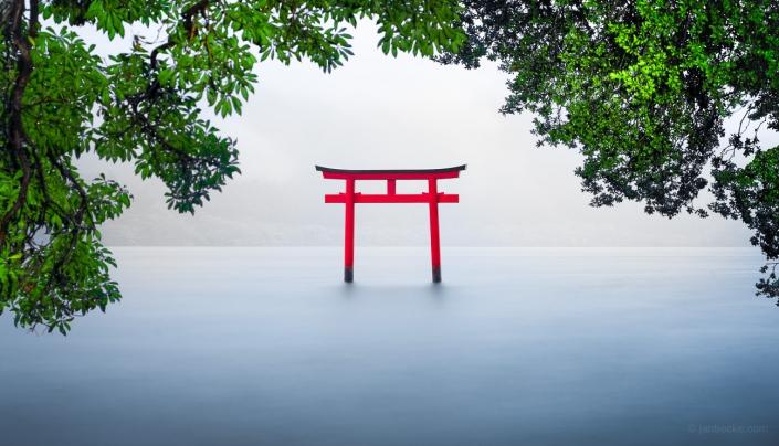 Red torii gate on lake Ashi near Hakone, Japan
