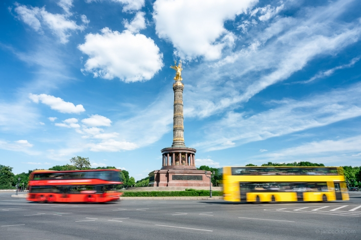 Tourist busses driving by the Berlin Victory Column at the Großer Stern Square