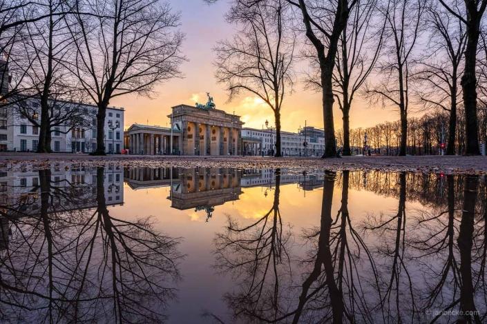 Brandenburg Gate reflection in winter, Berlin, Germany