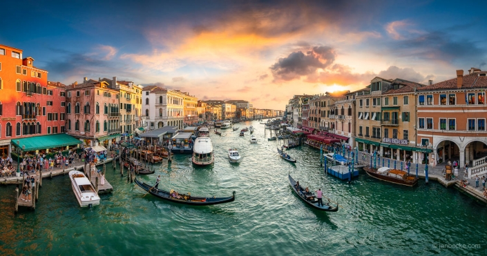 Canal Grande sunset panorama with tourists and gondola, Venice, Italy