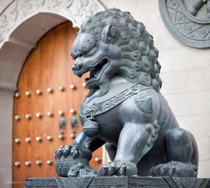 Chinese guardian lion statue in front of Jing'an temple