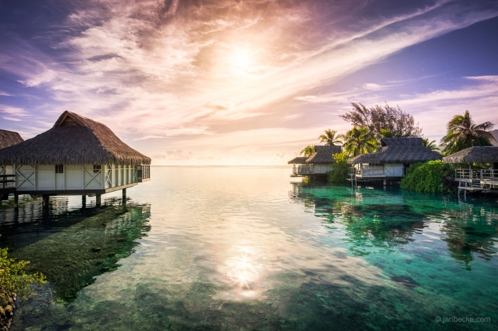 Colorful sunset at a luxury beach resort on Moorea