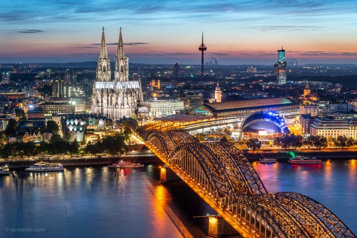Aerial view of the Cologne Cathedral with Hohenzollern Bridge at night