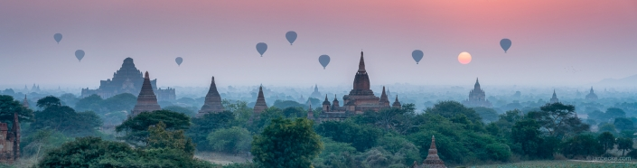Hot-air balloons flying over Bagan at sunset