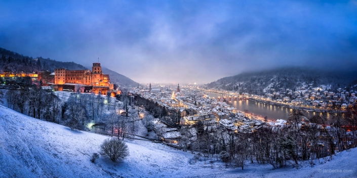 Heidelberg in winter with castle and old town covered in snow