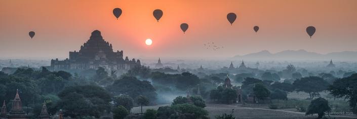 Dhammayangyi Temple at sunrise with hot-air balloons, Bagan, Myanmar