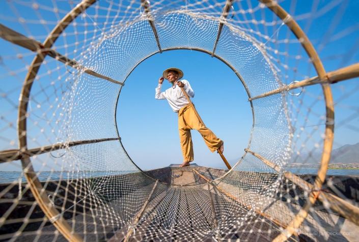 Traditional Intha fisherman with fishing net near Inle Lake in Myanmar