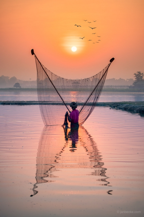 Fisherman at the Inle Lake in Myanmar with fishing net