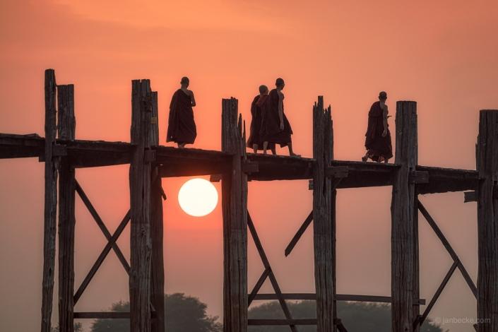 Buddhist monks crossing the U Bein Bridge near Amarapura in Myanmar
