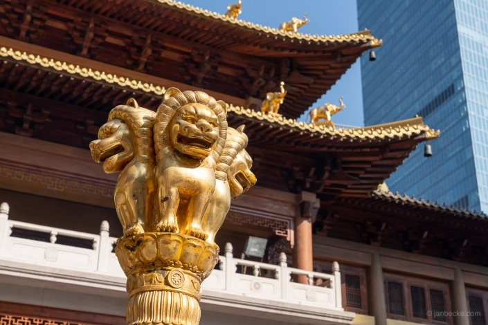 Buddhist Jing'an temple with golden lion statue in Shanghai, China