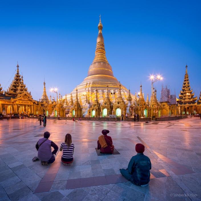 People praying in front of Shwedagon Pagoda in Yangon, Myanmar