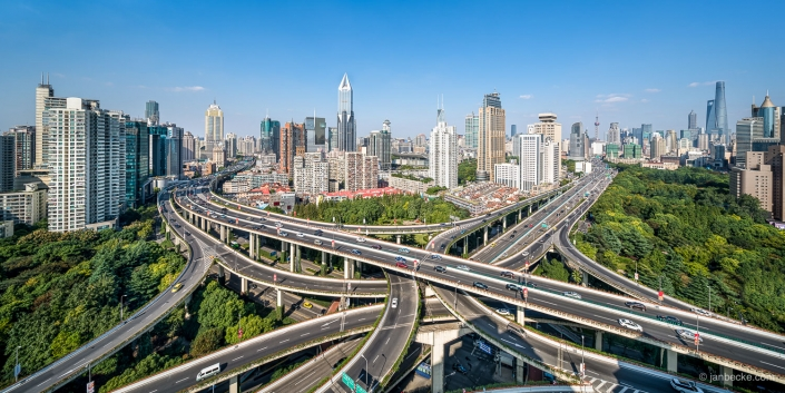 Shanghai intersection road with view towards the skyline