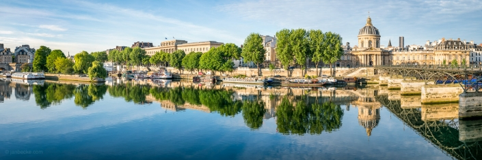 Panorama view of the Institut de France and Pont des Arts in Paris, France