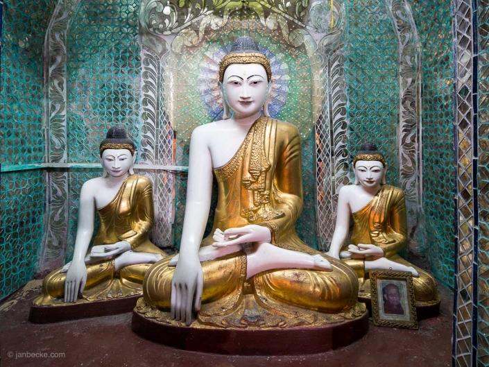 Buddhist statues at the Shwedagon Pagoda in Yangon, Myanmar