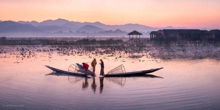 Group of Intha fishermen on Inle Lake in Myanmar at dusk