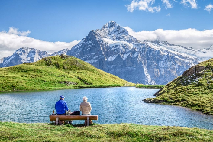Two hikers taking a rest near Bachalpsee in the Swiss alps, Switzerland