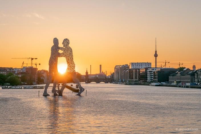 Molecule Man statue at sunset, Berlin, Germany
