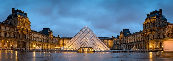 Musée du Louvre panorama with pyramid at night