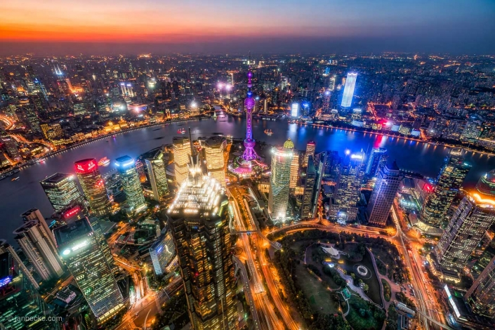 Pudong skyline at night with Oriental Pearl Tower and Huangpu river