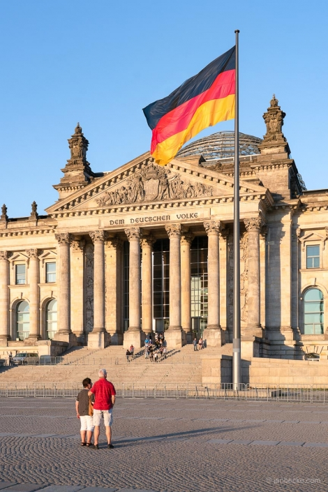 Berlin Reichstag building with German flag