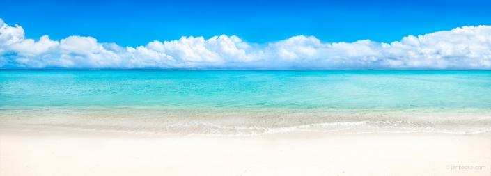 Panorama of a white sandy beach on Bora Bora