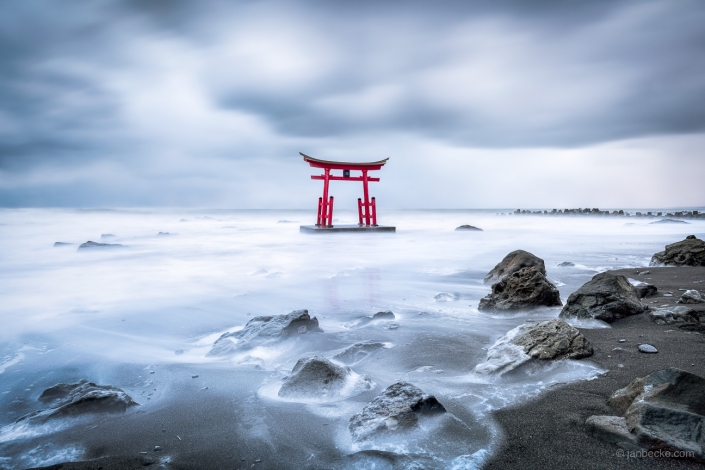 Red torii gate in the northern sea of Japan