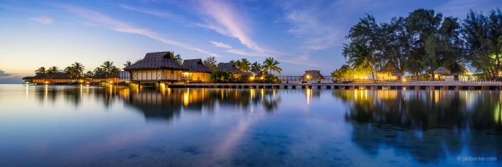Overwater villas at a luxury beach resort in French Polynesia