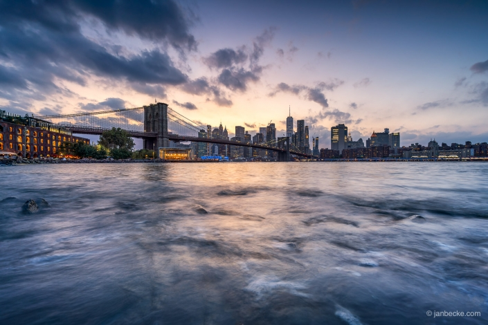 Brooklyn Bridge and Manhattan skyline at sunset seen from the Dumbo district in Brooklyn