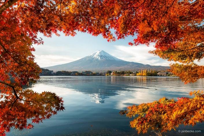 Mount Fuji with water reflection at Lake Kawaguchiko during autumn season