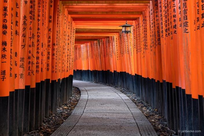 Row of red torii gates at the Fushimi Inari Taisha Shrine in Kyoto